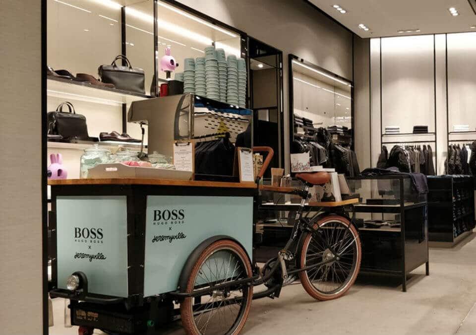 Coffee bike inside Hugo boss next to handbags