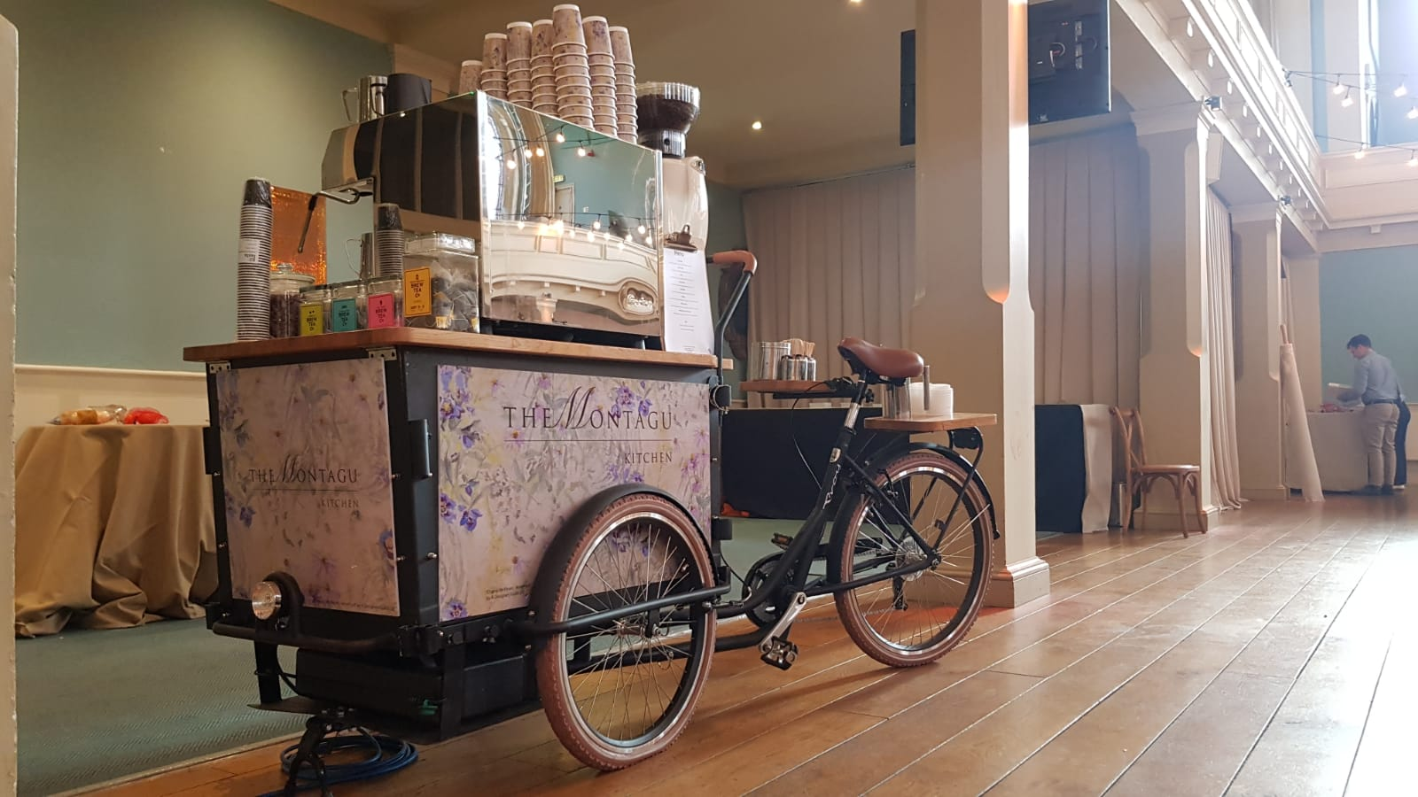 A coffee bike on a sunny day at an exhibition
