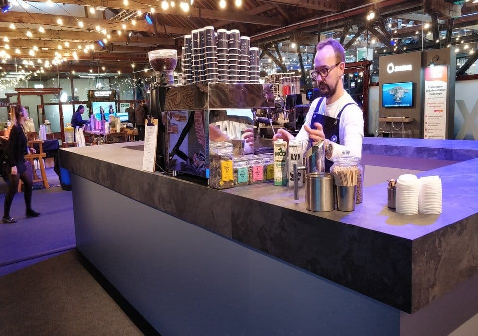 Barista making coffee at exhibition coffee stall