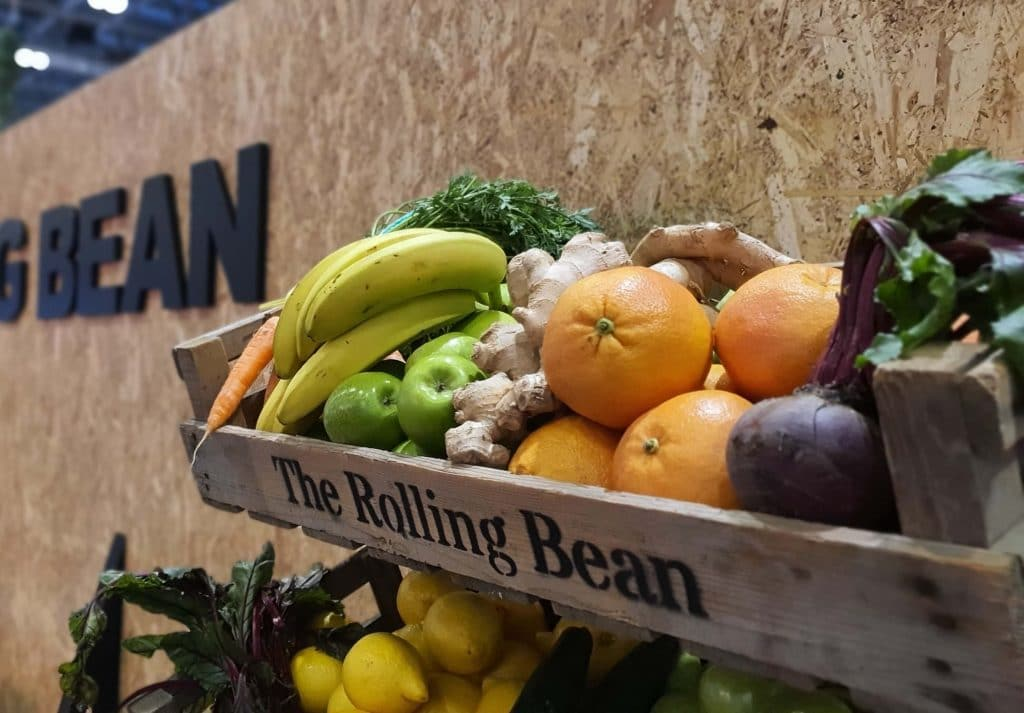 Wooden tray filled with fruits and vegetables, prepared for fresh smoothies and juices